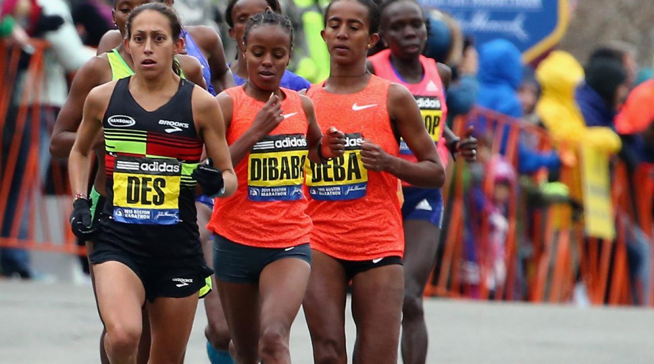 The elite women begin their 23rd mile, led by Desiree Linden, during the 119th Boston Marathon on April 20, 2015.